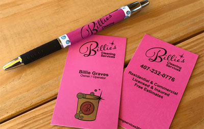 Hot pink business cards and pen with Billie's Cleaning Services Logo