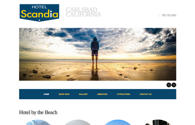 Hotel Scandia website featuring a surfer in a blue hoodie looking at the ocean